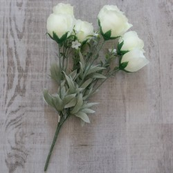 cream roses with leaves on the grey wood